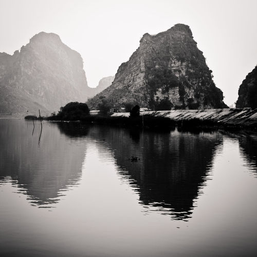 Kenh Ga - river landscape - vietnam Reflection Water Tranquil Scene Tranquility Sky Beauty In Nature Scenics - Nature Rock Mountain Waterfront Rock - Object Rock Formation No People Nature Lake Solid Day Idyllic Mountain Range Outdoors Vietnam
