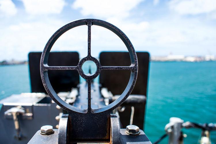 Close-up of gun on boat at sea