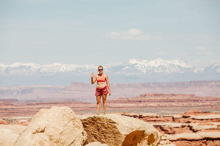 Full length of man standing on rock