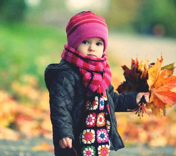 Cute girl. Childhood Focus On Foreground Warm Clothing Casual Clothing Jacket Looking At Camera Knit Hat Person Innocence Holding Red Person Day Pink Color Winter Coat First Eyeem Photo
