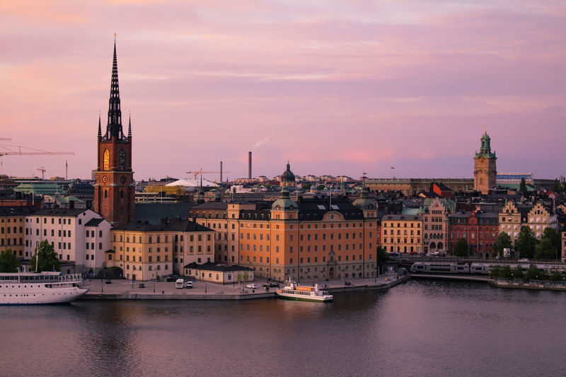 Church Harbor Historical Building Houses Nordic Countries Old Town Scandinavia Sweden Taking Pictures Architecture Boat Capital Cities  City Scape Cityscape Evening Sky Gamla Stan History Nautical Vessel Place Of Worship Religion Sunset Tall - High Travel Destinations Viewpoint Waterfront