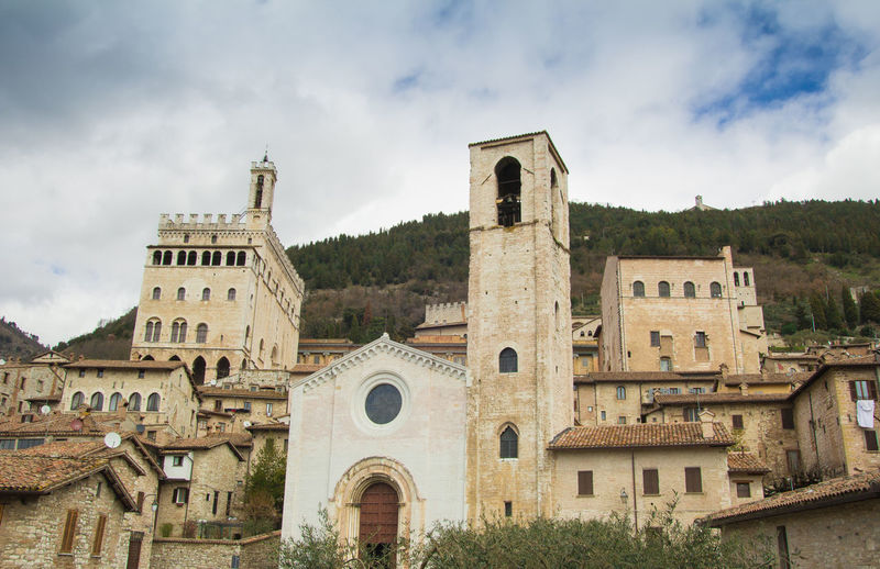 Urban view of Gubbio medieval town in Umbria, Italy Church Cityscape Architecture Belief Building Building Exterior Built Structure Cloud - Sky Day Europe Gubbio Historic History Italy Medieval No People Outdoors Place Of Worship Religion Religious  Sky Spirituality Town Travel Destinations Umbria