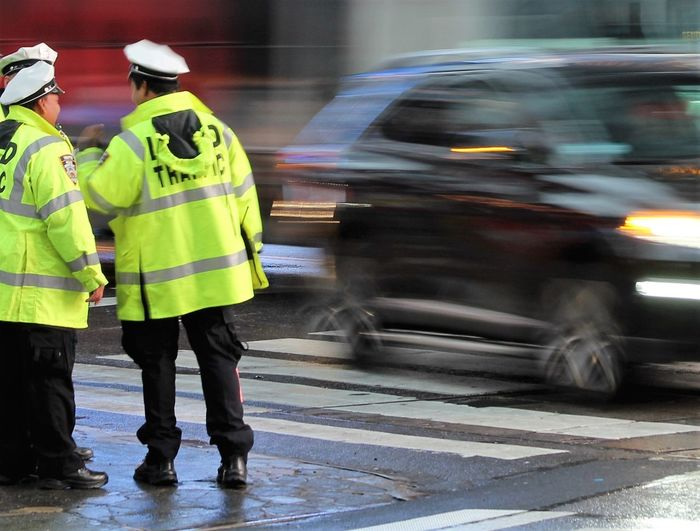 Traffic cops standing on street