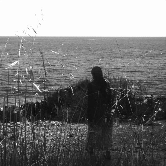 Lured by the glimmering sea Water Sky Real People Horizon Lifestyles Horizon Over Water Nature One Person Leisure Activity Plant Sea Beauty In Nature Day Scenics - Nature Tranquility Clear Sky Grass Land Men Outdoors Abstract Photography Double Exposure Black & White