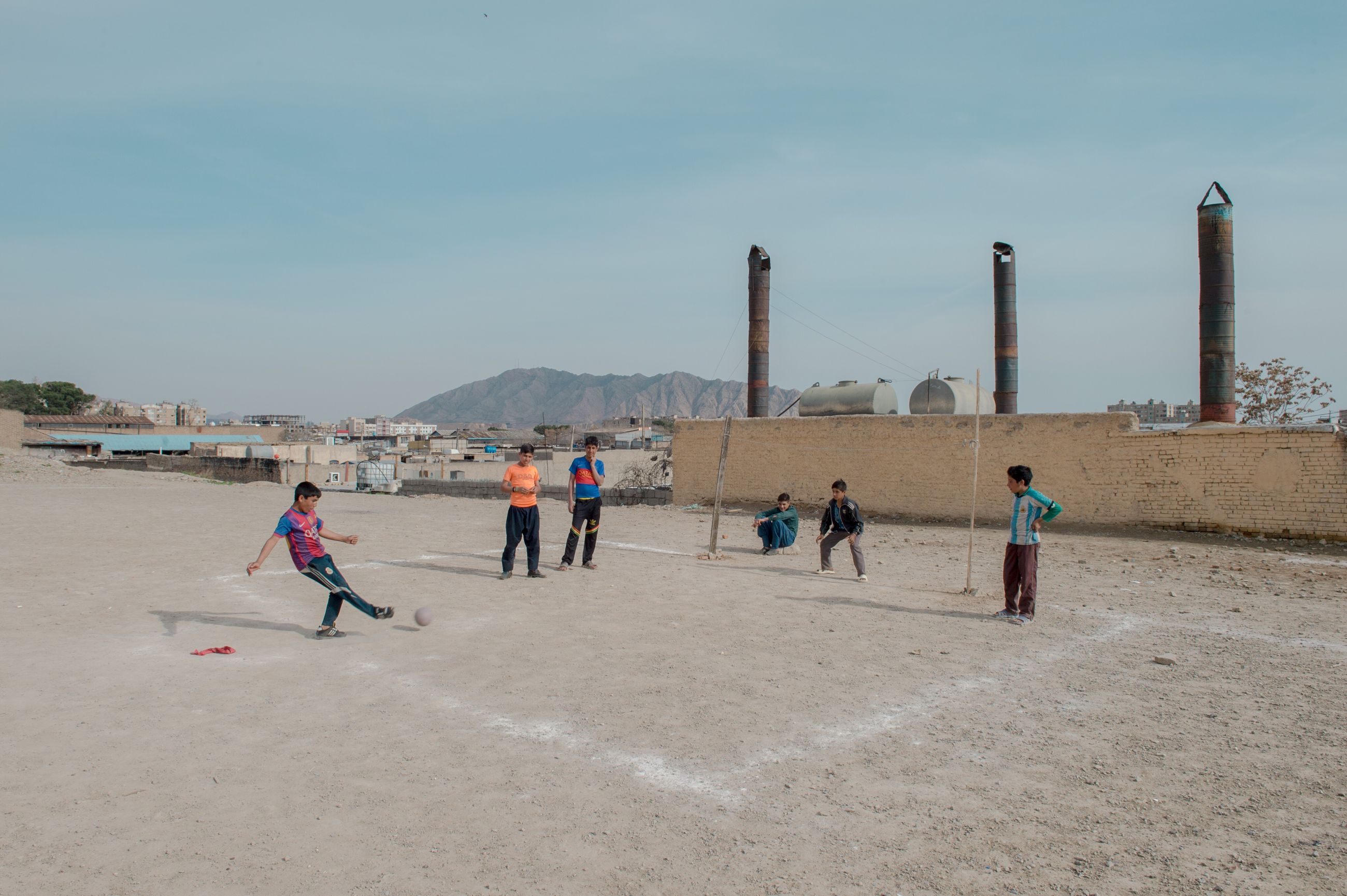 real people, day, lifestyles, leisure activity, playing, outdoors, men, sky, mountain, nature, people