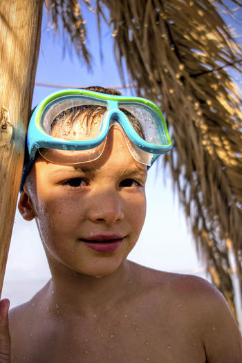 A boy with the swimming goggles. Diving Goggles Snorkeling Swimming After Swimming Beach Boy Portrait Boy Swimmer Leisure Activity Sea Drops Snorkeling Mask Swimmer Swimming Goggles Swimming Time Wet Goggles Wet Skin
