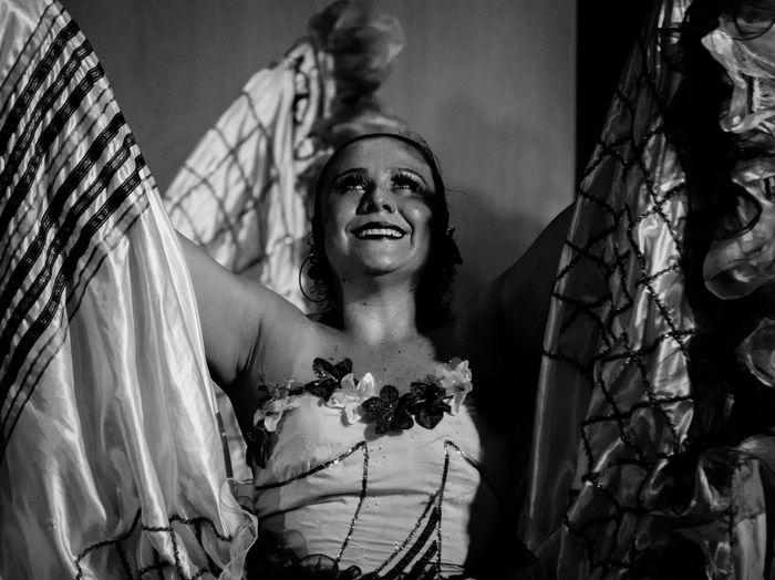 Smiling woman wearing costume looking away
