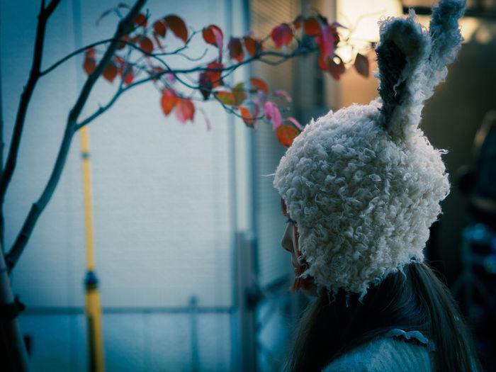 Side view of woman wearing bunny headwear