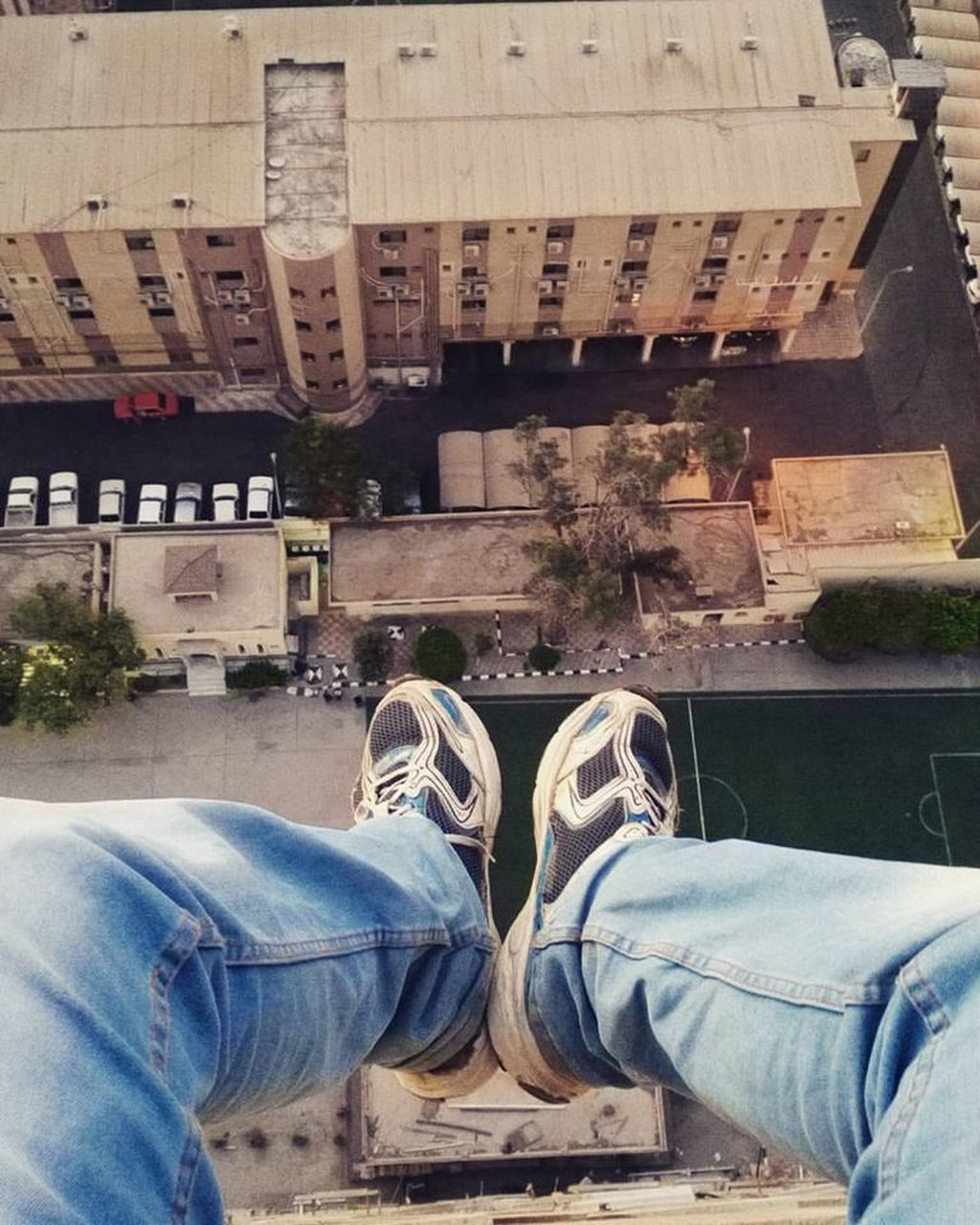 shoe, low section, canvas shoe, high angle view, human leg, outdoors, day, one person, architecture, real people, men, human body part, building exterior, city, close-up, people