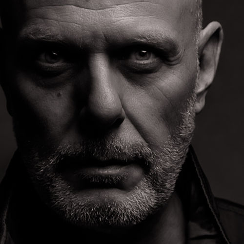 Portrait Of Mature Man Against Gray Background