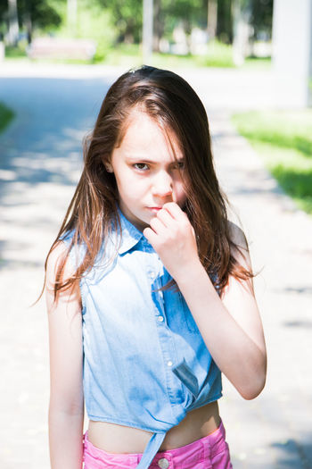 angry girl Girls One Person Child Front View Real People Focus On Foreground Childhood Day Women Lifestyles Leisure Activity Portrait Females Casual Clothing Waist Up Hair Innocence Brown Hair Hairstyle Outdoors Pre-adolescent Child Contemplation