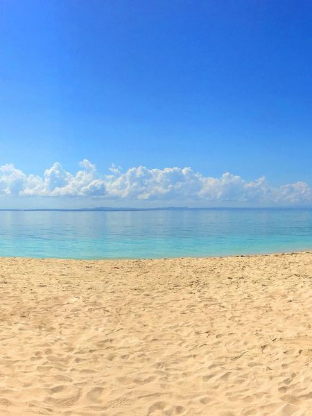 Travel Destinations Tourism Beach Sand Blue Horizon Over Water Sea Sky Scenics Day Nature Beauty In Nature Water Outdoors Vacations Cloud - Sky Tropical Climate Scenery Landscape