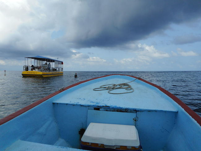 Honduras Roatan Bay Islands Beauty In Nature Boat Cloud - Sky Day Horizon Over Water Mode Of Transport Nature Nautical Vessel No People Outdoors Scenics Sea Sky Tranquility Transportation Water