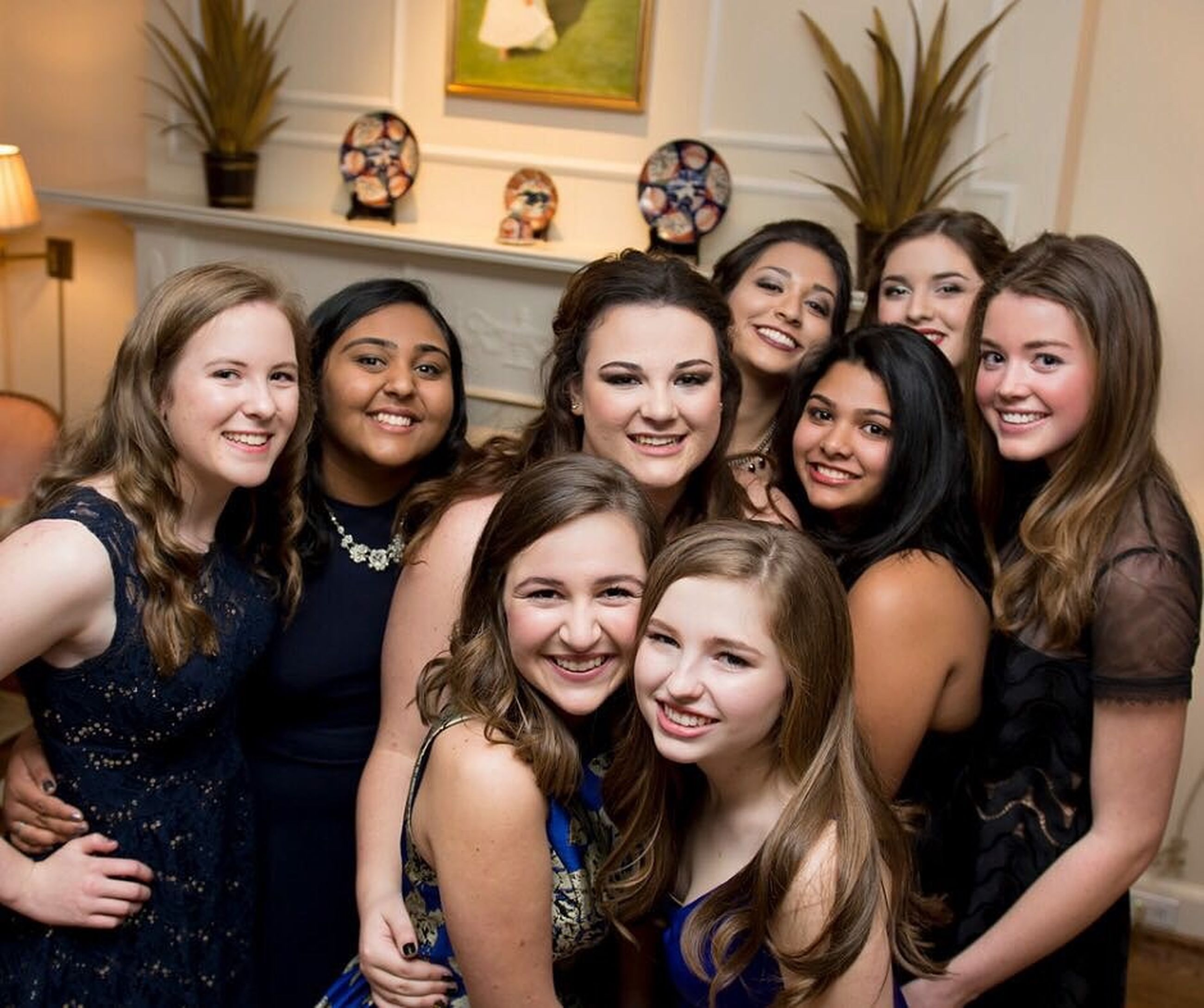 togetherness, lifestyles, leisure activity, indoors, large group of people, friendship, happiness, bonding, young women, person, young adult, celebration, smiling, front view, fun, portrait, looking at camera, enjoyment