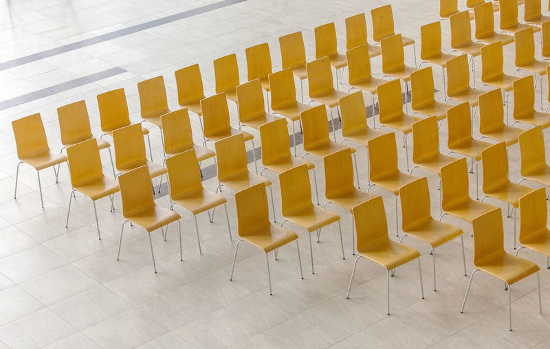 Empty chairs on tiled floor