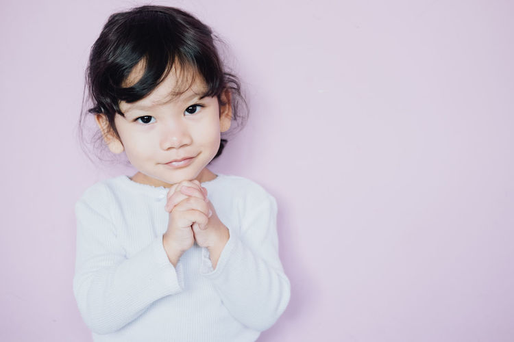 Little asian girl hand praying , spirituality and religion, Christianity concept. Pray background. Childhood Child One Person Innocence Cute Beautiful Praying Spirituality Religion Christianity .. Concept Pray Belief Believe Christian Faith Grace Hand Happy Holy Spirit Hope Joy Kid Love Thanksgiving