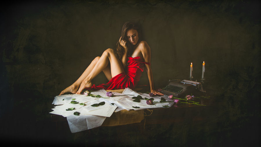Young woman sitting on table
