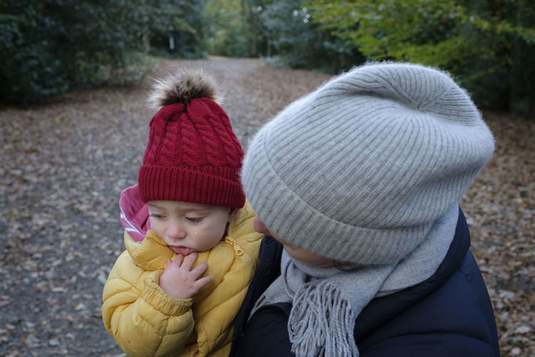 Childhood Child Clothing Winter Warm Clothing Hat Togetherness Knit Hat Baby Family Innocence Day Outdoors Positive Emotion Teardrop Tear Crying