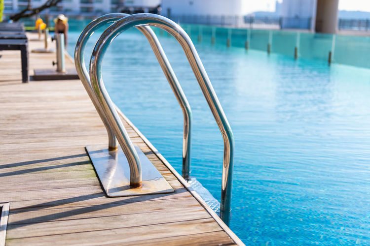 Summer Vacation Holiday Ladder Relaxing Shiny Stairs Steps Sunlight Swimming Travel Vacations Beach Blue Day Grab Bar Handrail  Leisure Activity Outdoors Pool Relaxation Sea Summer Sun