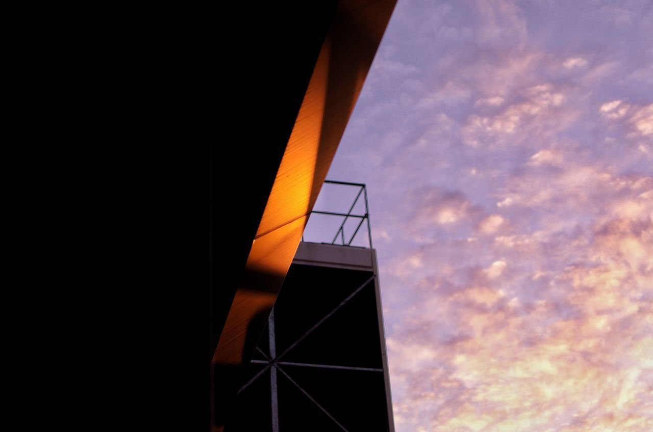sky, low angle view, architecture, built structure, sunset, cloud - sky, building exterior, no people, nature, orange color, outdoors, building, city, modern, tower, tall - high, day, copy space, railing, staircase