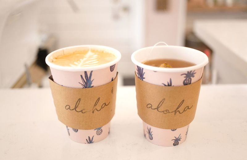 Latte & Tea served with Aloha Two Cups Coffee Break Coffee Or Tea Hipster Coffee Designer Coffee Cup Pineapple Print Herbal Tea Pink Paper Cup Coffee Cup Sleeve Aloha Cafe Hipster Coffee Shop Latte Coffee Tea Tea - Hot Drink Coffee Cup Coffee - Drink Text Focus On Foreground Drink Communication Food And Drink Froth Art