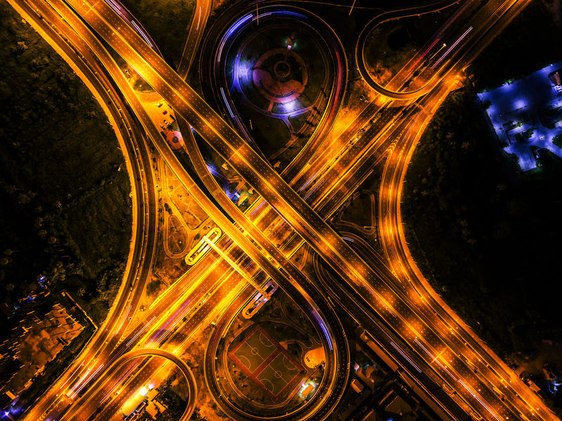 Aerial View Architecture Blurred Motion Bridge - Man Made Structure Built Structure City Curve High Angle View Highway Illuminated Land Vehicle Light Trail Long Exposure Motion Night No People Outdoors Road Rush Hour Speed Street Traffic Transportation
