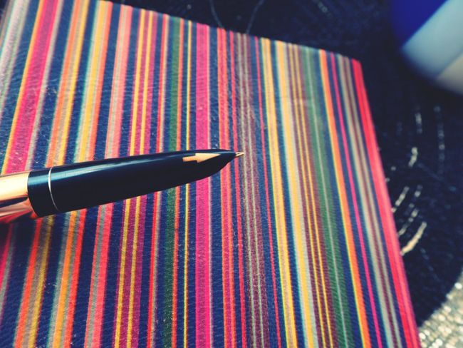 Striped Multi Colored Parallel Lines Lines, Colors & Textures Lines And Patterns Neon Life Golden Pen Writing Instrument Pen Nibs Nib Arrow Symbol EyeEmNewHere Notebook Writing Notebook Cover Old-fashioned Retro Styled Education Knowledge Time To Study Motivation Knowledge Is Freedom Knowledge Is Power Still Life Pen