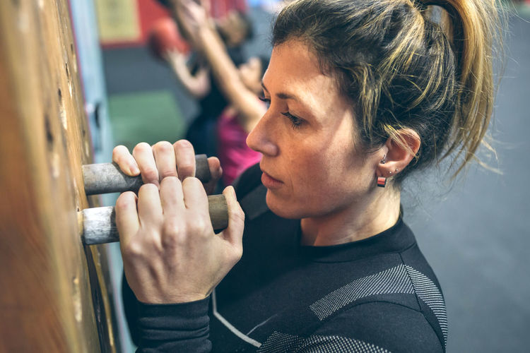 High angle view of woman exercising in gym