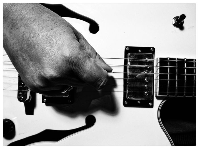 Cropped image of musician playing electric guitar