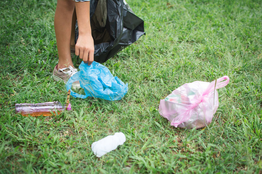 Volunteer Bag Day Girl Grass Holding Leisure Activity Lifestyles Nature One Person Outdoors Plastic