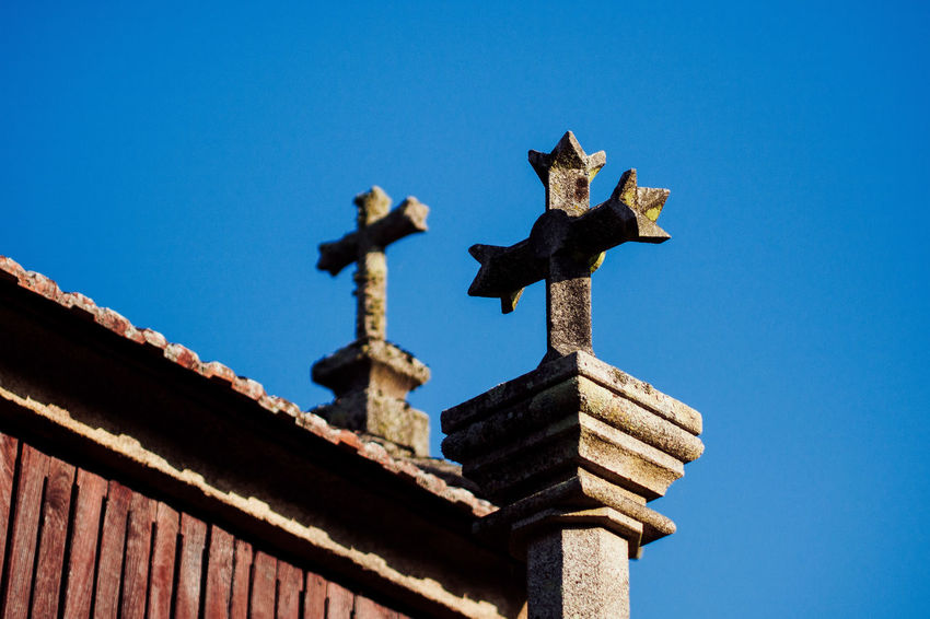 lost in spain Architecture Blue Building Exterior Built Structure Clear Sky Cross Day Gargoyle Hikinggalicia Low Angle View No People Outdoors Place Of Worship Religion Roof Sky Spirituality Statue Weather Vane