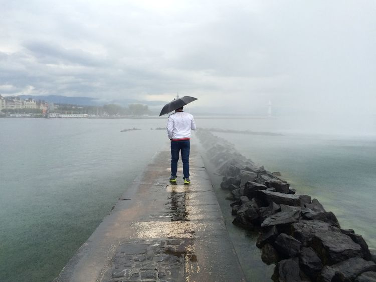 Under a giant fountain Cloud - Sky Dramatic Sky Footpath Meditating Rain Tranquil Scene Umbrella Water