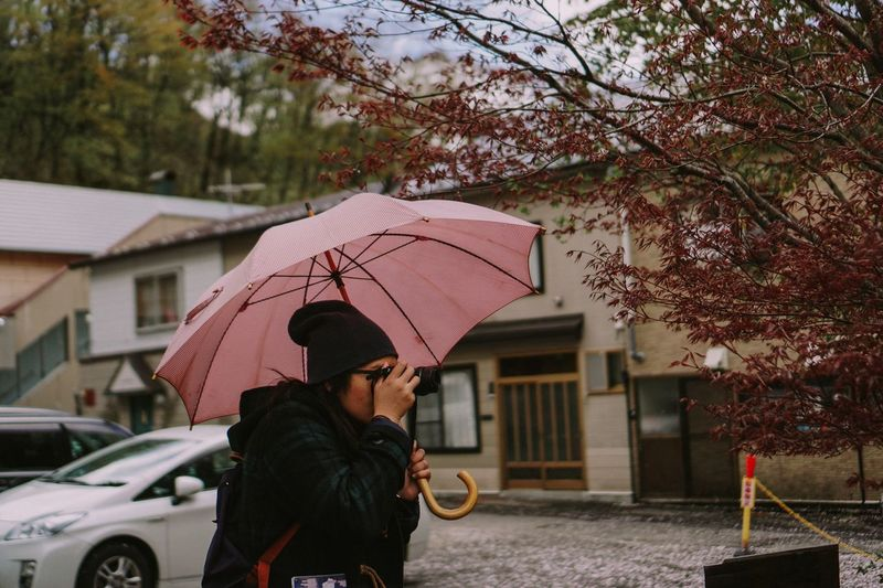 Woman taking photo Protection Rain One Person Tree Holding Outdoors Adults Only One Woman Only Only Women Real People People Adult Sky Young Adult Day Womanphotographer Photography Ladyphotographerofthemonth Japan Eyeemmarket EyeEmBestPics EyeEm Gallery EyeEm Best Shots Candid Portrait