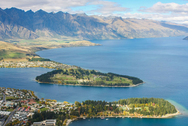 Aerial view of Queenstown, New Zealand Water Scenics - Nature Beauty In Nature Tranquil Scene Mountain Tranquility Nature Sky Sea No People Day Cloud - Sky Mountain Range Plant Idyllic Non-urban Scene Outdoors Land