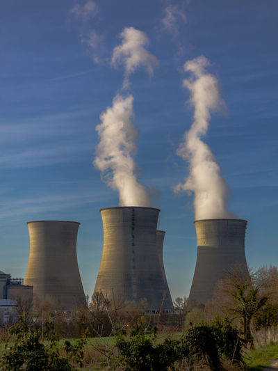 Air Pollution Architecture Building Exterior Built Structure Cooling Tower Day Emitting Environment Environmental Damage Environmental Issues Factory Fuel And Power Generation Industry Nature No People Nuclear Outdoors Pollution Power Station Sky Smoke - Physical Structure Smoke Stack