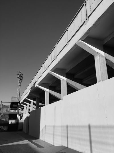 Built Structure Architecture Transportation Bridge - Man Made Structure Connection Low Angle View Outdoors No People Day Clear Sky Road Building Exterior Sky Stadium Football Soccer Soccer Field España Club Blackandwhite Perspective Maspalomas Gran Canaria Las Palmas De Gran Canaria Summer