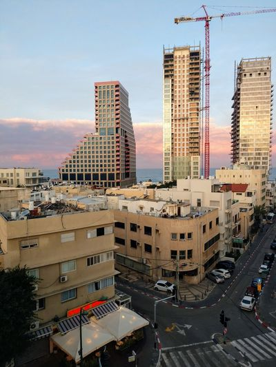 sunrise in Tel Aviv Skyscraper Architecture City Business Finance And Industry Downtown District Building Exterior Cityscape City Life Urban Skyline Built Structure Sky Outdoors No People Day