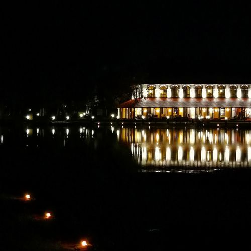 Reflections of a building in the backwaters of. Kerala Water Illuminated Cityscape Reflection Architecture Building Exterior Built Structure Waterfront Standing Water Rippled Scenics Lakeside Calm