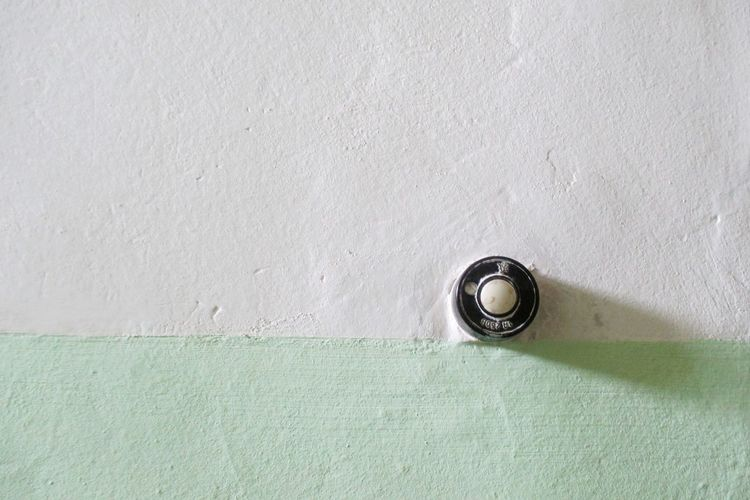 Close-up of doorbell on wall