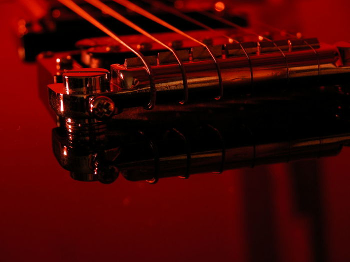 Guitar in Fire.. Red Guitar Close-up No People Perspective Steel Blackandred EyeEmNewHere