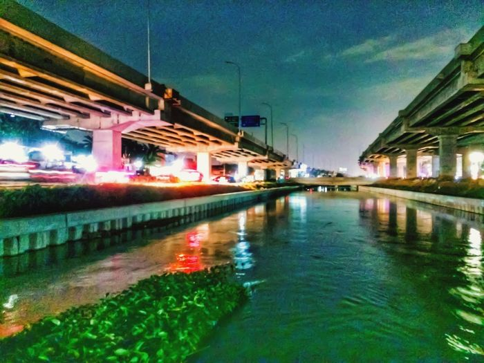 River kalimalang Bekasi Bekasi, Indonesia Built Structure Architecture Reflection Building Exterior Water Illuminated City Night Street Transportation Residential District Canal Dusk Nightlife Nightphotography
