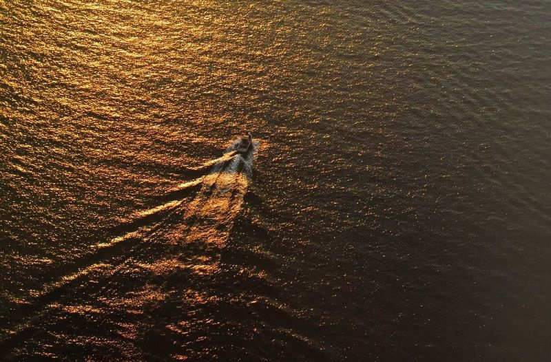 High Angle View Of Boat Moving In Sea During Sunset