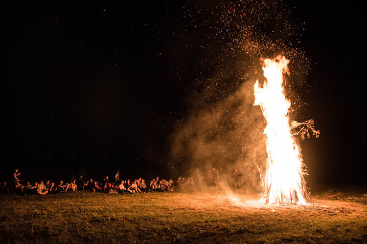 Bonfire on field with fire crackers at night