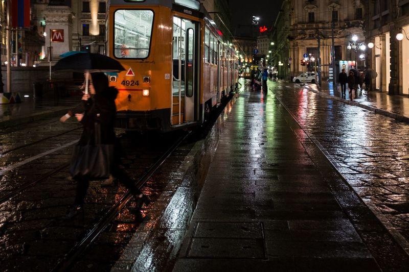 View of illuminated city street at night