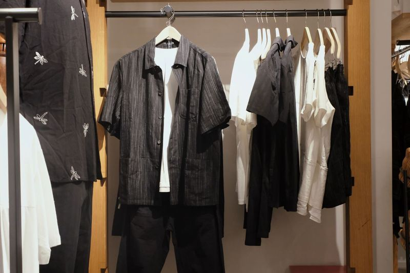 Hanging Clothing Coathanger No People Indoors  Coat Fashion Clothes Rack Jacket Button Down Shirt Textile In A Row Still Life Business Lifestyles Side By Side Black Color Variation Choice Menswear