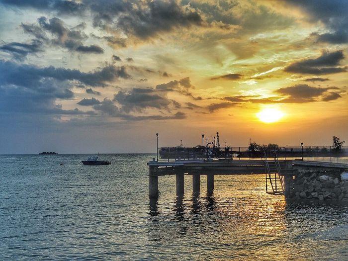 Sunset at the beach EyeEmNewHere M. Zuiko 14-150mm F4.0-5.6 Ii Boat Sea Sunset Horizon Over Water Water Sky Beach Silhouette Beauty In Nature Cloud - Sky Scenics Outdoors No People EyeEmNewHere