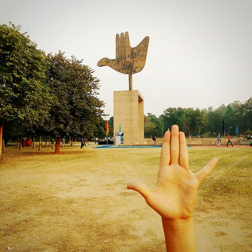 The Open Hand Monument Capitol Complex Chandigarh Chandigarhdiaries Human Body Part Built Structure Architecture Tree Human Hand Sky Outdoors Day EyeEm Gallery Check This Out Architecture Moto G Shot Moto G3 Photography The Architect - 2017 EyeEm Awards Neighborhood Map