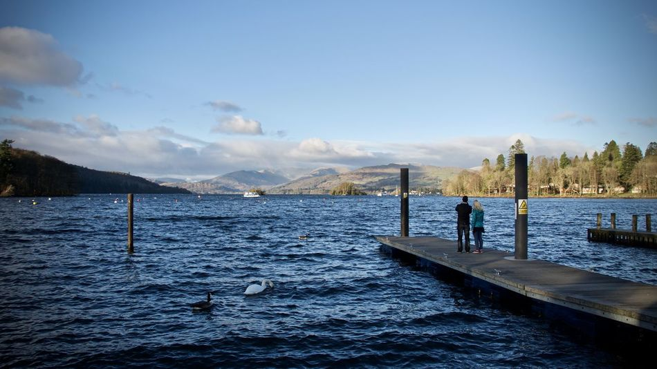 Adult Adults Only Beauty In Nature Blue Cloud - Sky Day Idyllic Lake Lake District National Park Lake Windermere Landscape Men Mountain Nature One Person Outdoors People Real People Scenic Scenics Sky Tranquility Water Winter Women