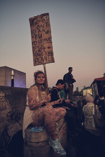Extinction Rebellion London - Day 7 of Protests on Waterloo Bridge Extinction Rebellion Climate Change Protest Climate Change Streetphotography Street Photography People People Photography Real People Lifestyles Women Sky Group Of People Young Adult Adult Clear Sky Leisure Activity Architecture Text Young Women Communication Nature Casual Clothing Looking At Camera Sitting Sunset Art And Craft