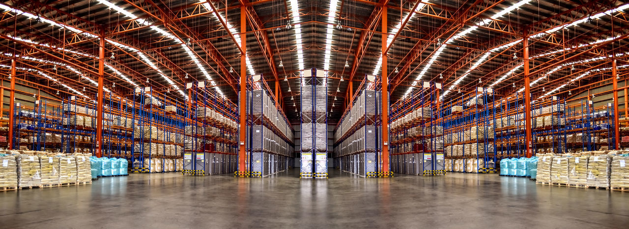 Large distribution warehouse interiors, logistics center.